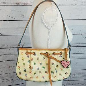 Make an offer! Dooney & Bourke tassel top purse.